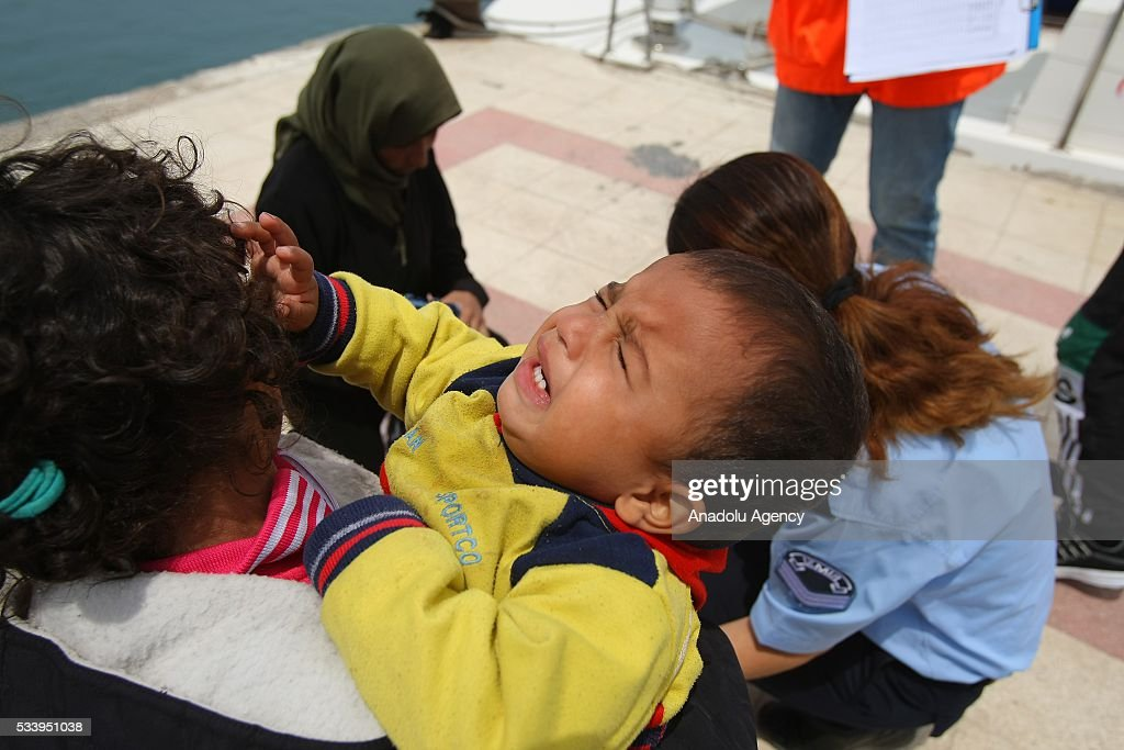 A baby cries as refugees wait after they were captured by coast guard while trying to pass illegally to Chios of Greek from Cesme in Izmir, Turkey on May 24, 2016. Turkish coast guard captured approximately 42 refugees after the operation.