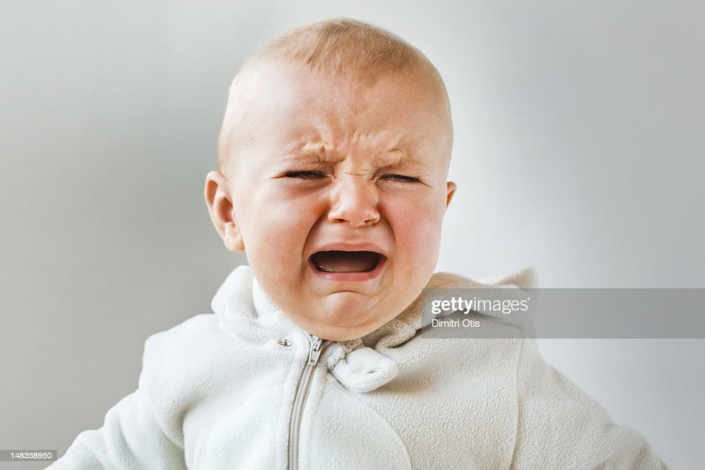 Baby crying, screaming and howling, close-up : Stock Photo