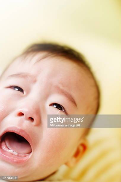 Baby crying with mouth open