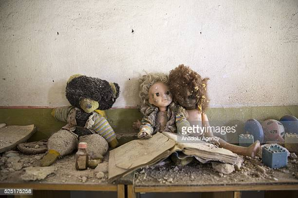 Baby dolls are seen at the abandoned kindergarden at a village close to Pripyat is seen during the 30th anniversary of Chernobyl nuclear disaster in...