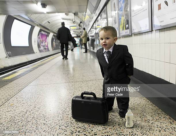 baby dressed as businessman, commuting