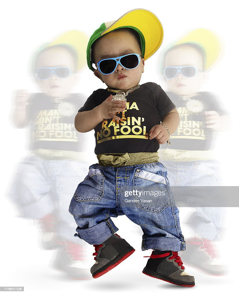 Baby dressed as urban rapper dancing : Stock Photo