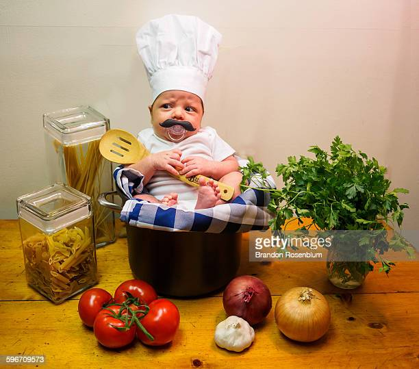 Baby dressed up as a chef for Halloween