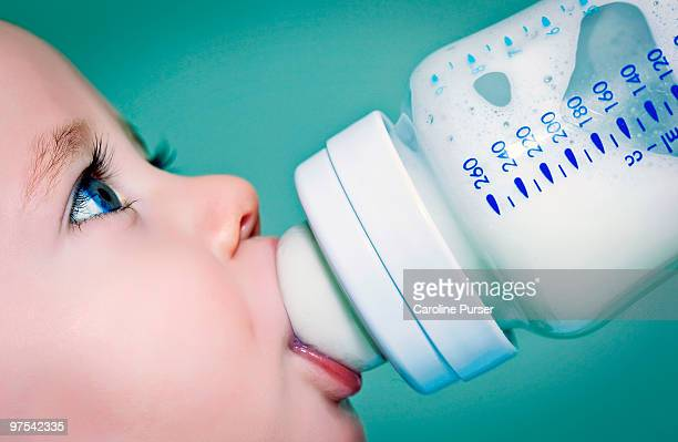 Baby drinking milk (or formula) from a baby bottle