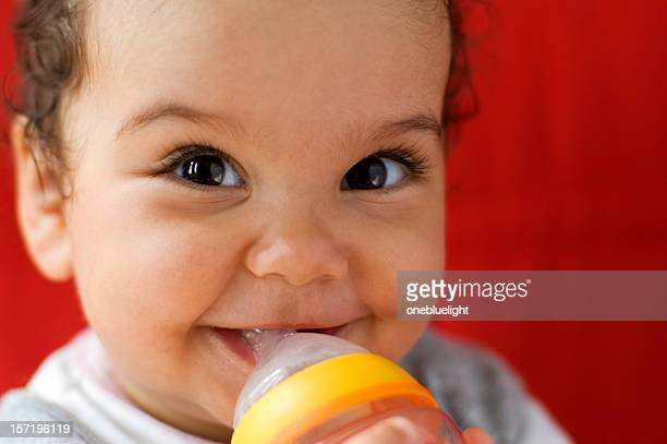 Baby drinking milk out of a bottle