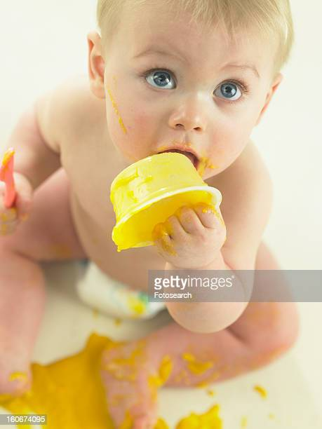 Baby eating and making mess