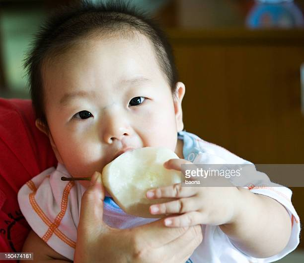 baby eating pear