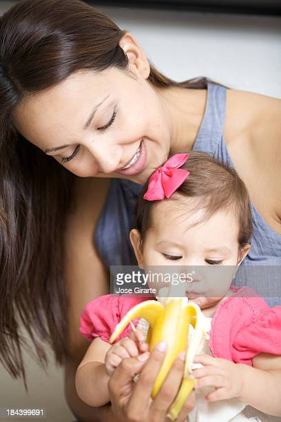 baby eating with mother