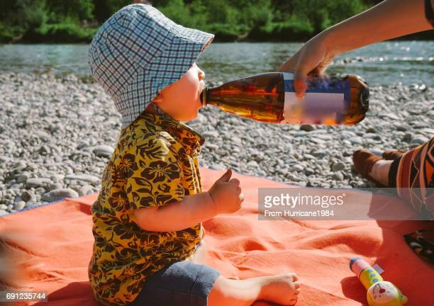 Baby enjoying juice