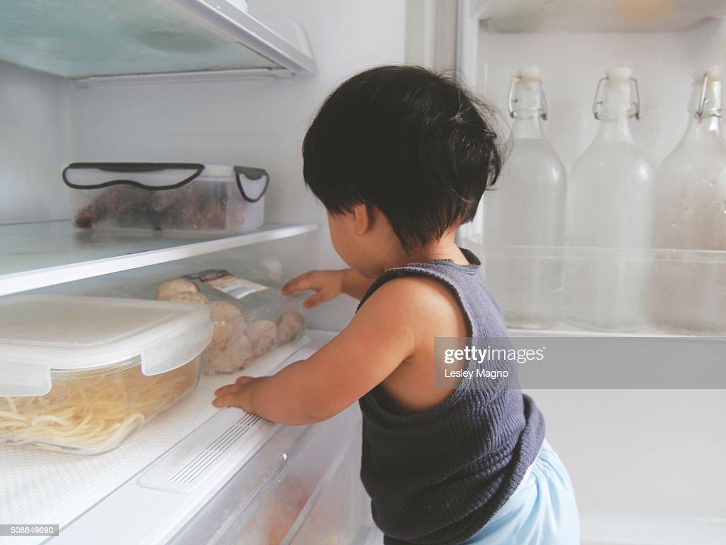 Baby exploring the refrigerator : Stock Photo