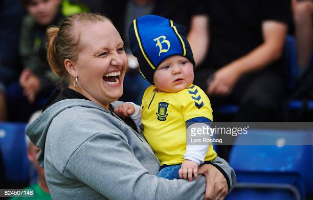 A baby fan of Brondby IF a the mother laughing prior to the Danish Alka Superliga match between Brondby IF and Lyngby BK at Brondby Stadion on July...