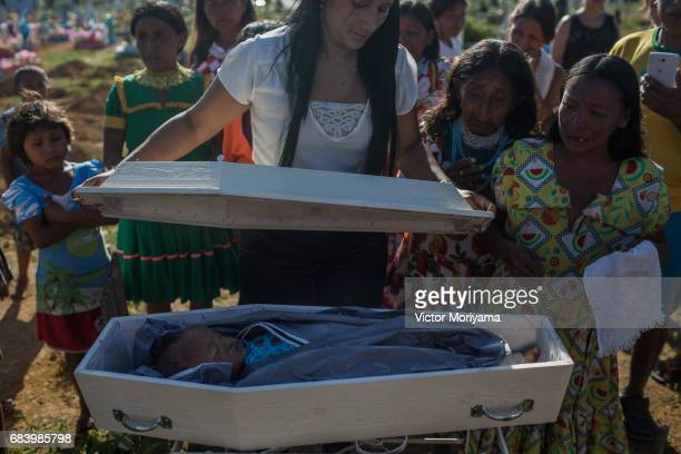 Baby Fernanda Rattia who died of pneumonia at 10 months is buried May 15 2017 in Manaus Brazil Parents Petra Cardona and Simon Rattia who are...
