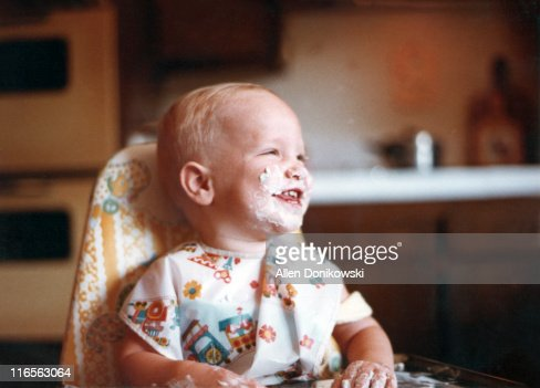Baby first birthday with cake on face : Stock Photo