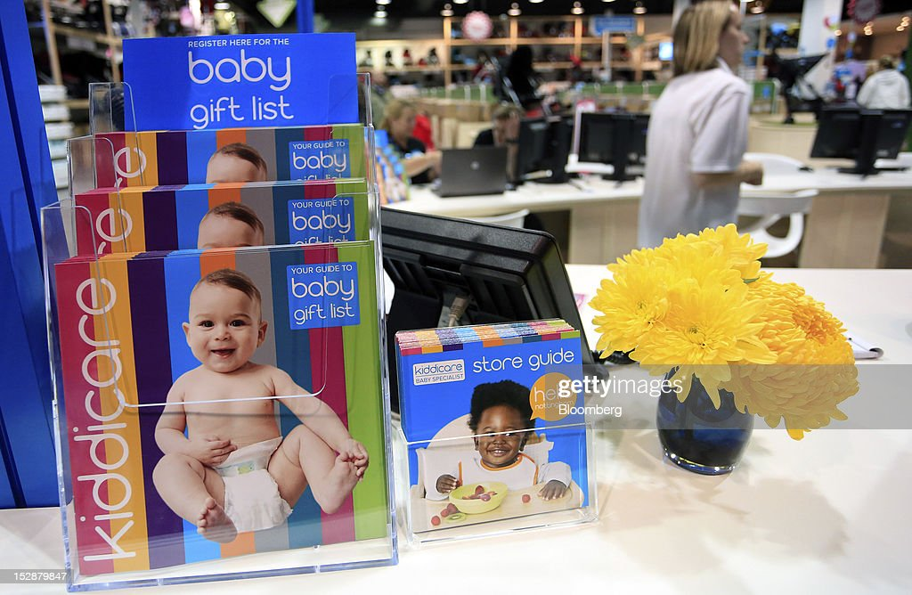 Baby gift brochures sit on display at the entrance to a Kiddicare Ltd. store, operated by WM Morrison Supermarkets Plc, in Nottingham, U.K., on Wednesday, Sept. 26, 2012. An index of U.K. retail sales rose for the first time in three months in September and stores expect demand to increase further next month, the Confederation of British Industry said. Photographer: Paul Thomas/Bloomberg via Getty Images