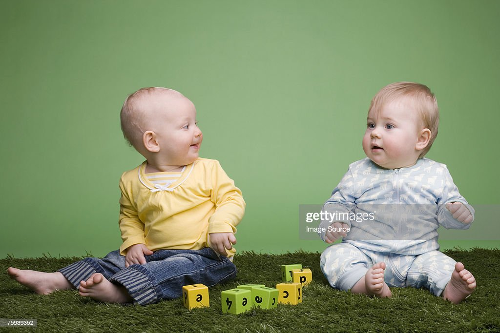 Baby girl and baby boy : Stock Photo