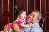Baby girl and her grandpa