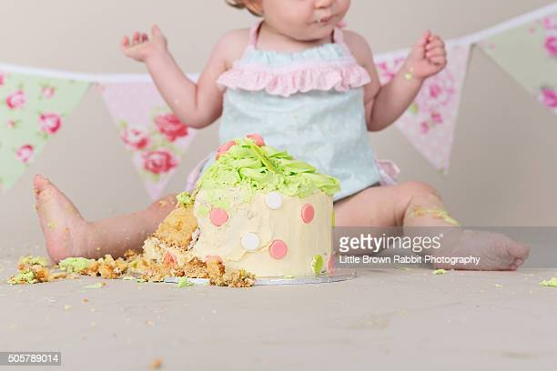 Baby Girl Celebrating Her First Birthday With Cake