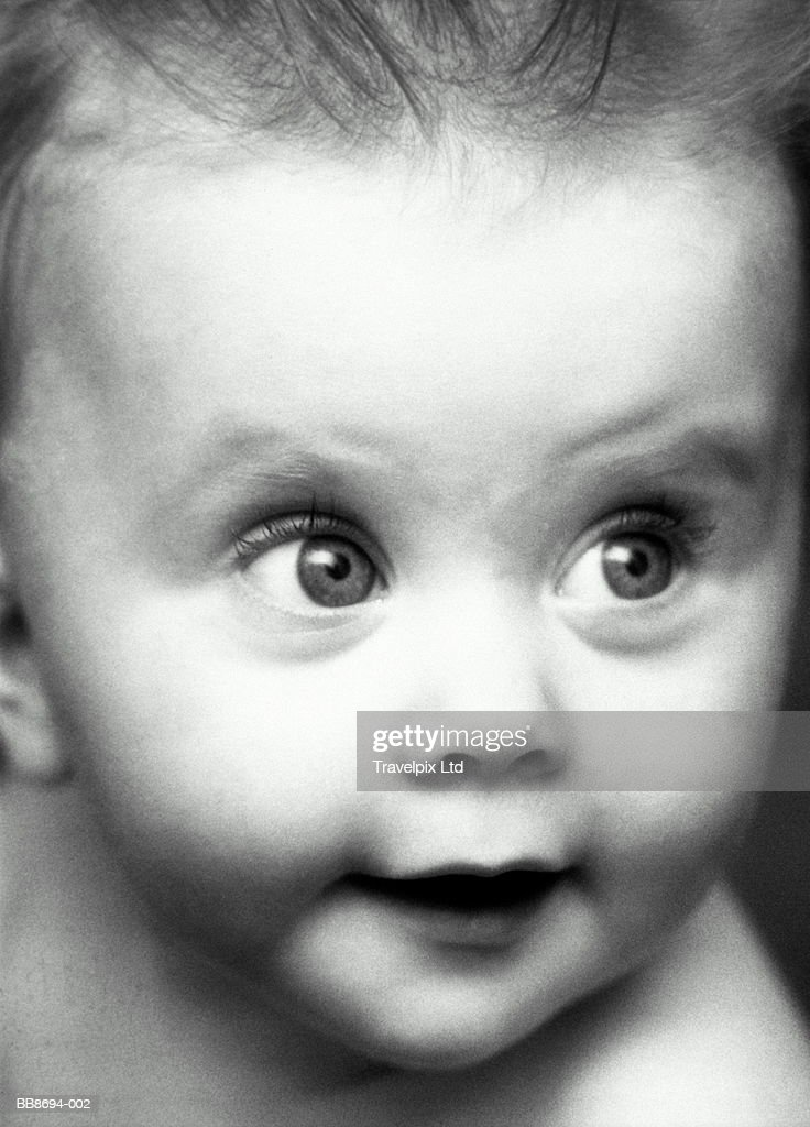 Baby girl (9-12 months), close-up (B&W) : Stock Photo