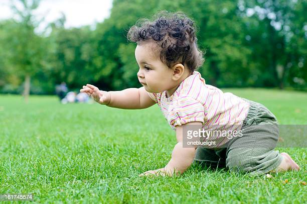 Baby Girl ( 8 months old ) Crawling On Grass