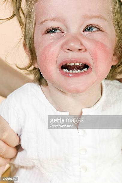 Baby girl (21-24 months) crying, close-up