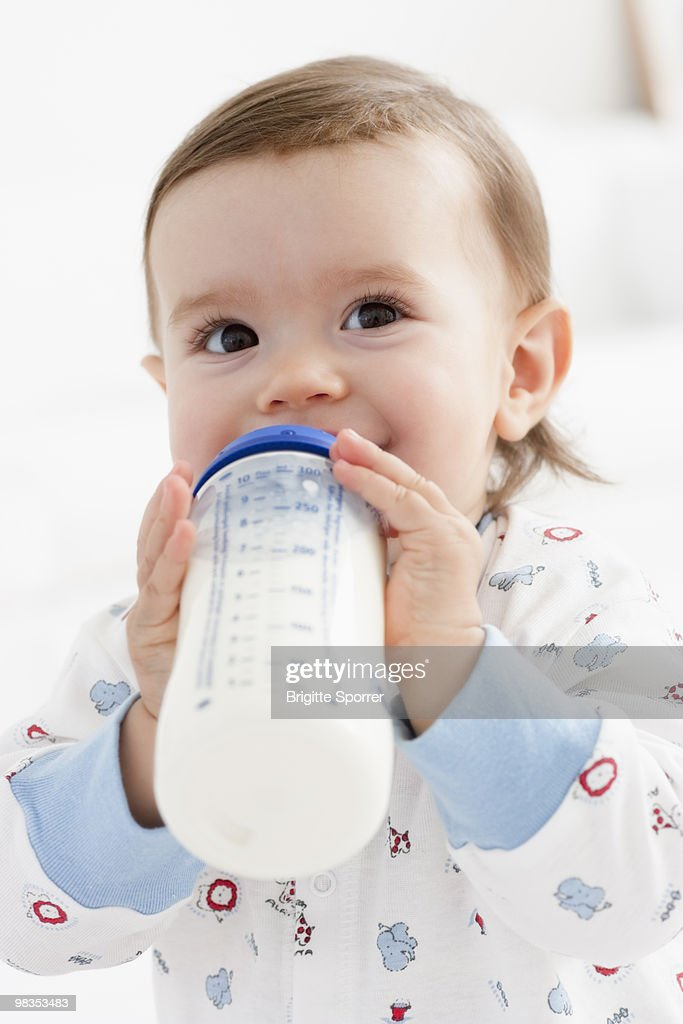 baby girl drinking milk : Stock Photo