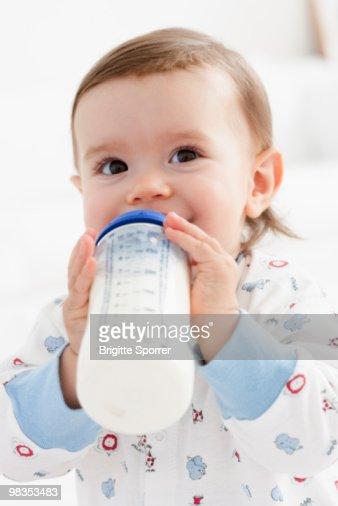 baby girl drinking milk : Foto de stock