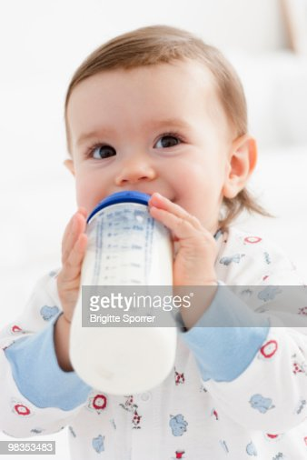baby girl drinking milk : Stock Photo