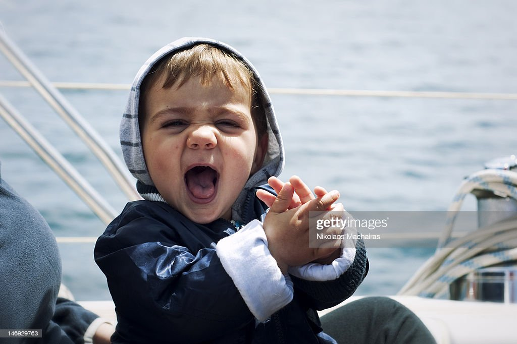 Baby girl enjoying boating moment : Stock Photo