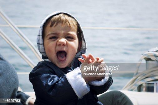 Baby girl enjoying boating moment : Stock Photo