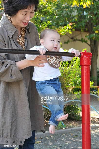 Baby Girl Holding Horizontal Bar