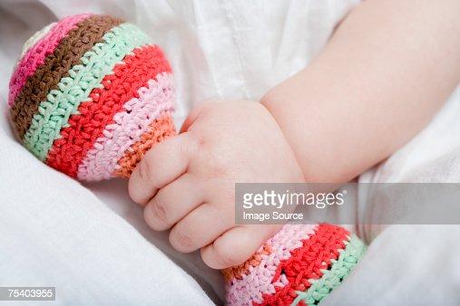 Baby girl holding rattle