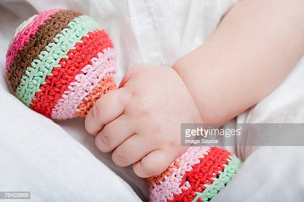 Baby girl holding rattle