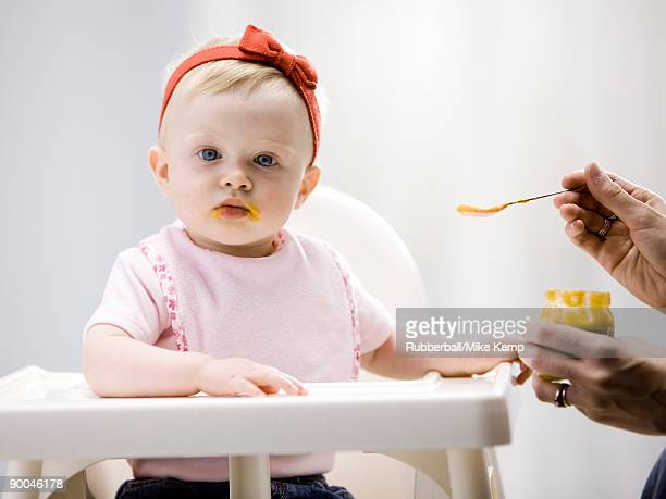 baby girl in a high chair