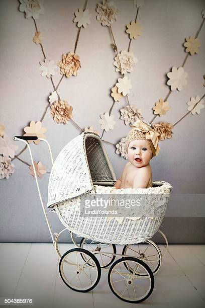 Baby Girl in Antique Pram