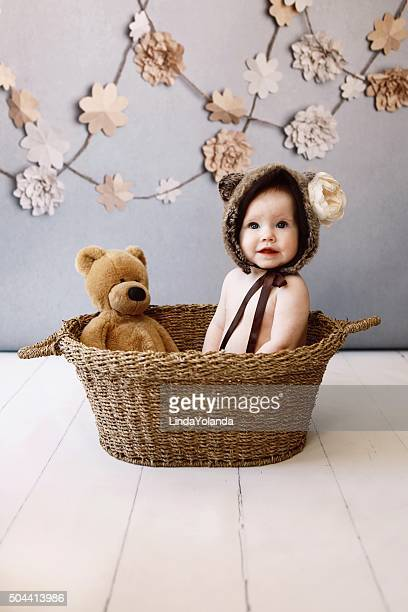 Baby Girl in Basket with Teddy Bear
