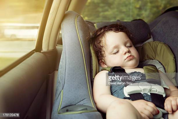 A baby girl in her car seat