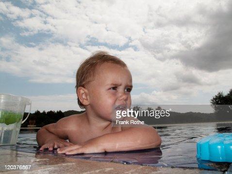 Baby girl in swimming pool : Stock Photo