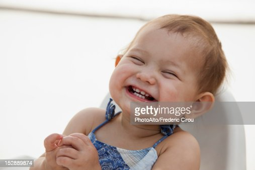 Baby girl laughing, portrait