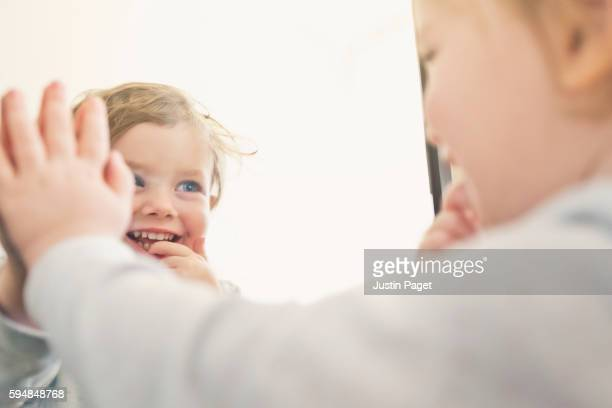 Baby Girl Looking into Mirror