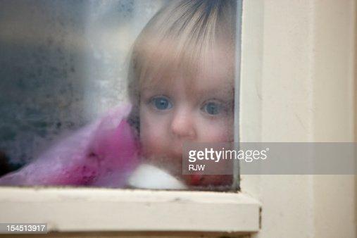 Baby Girl looking out of Window : Bildbanksbilder