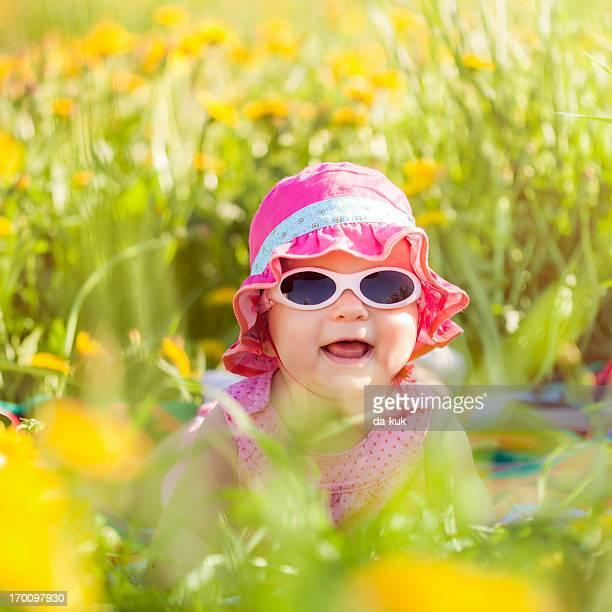 Baby girl lying in a field