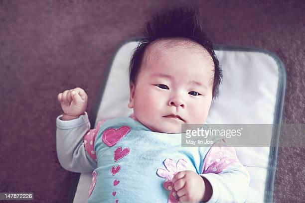 Baby girl lying on change mat