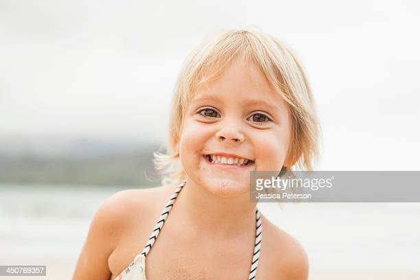 Baby girl (2-3) on beach