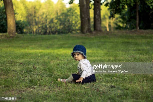 Baby Girl On Grass At Park