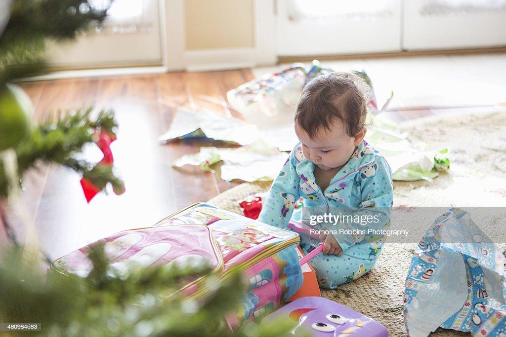 Baby girl opening christmas presents : Photo
