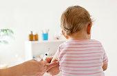 Baby Girl Patient Receiving Vaccine at doctor's office
