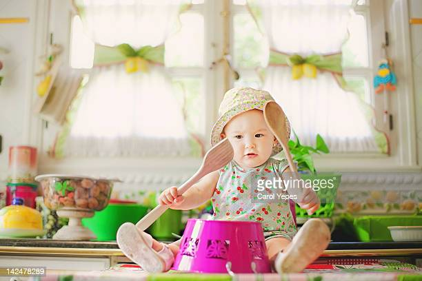 Baby girl playing drums
