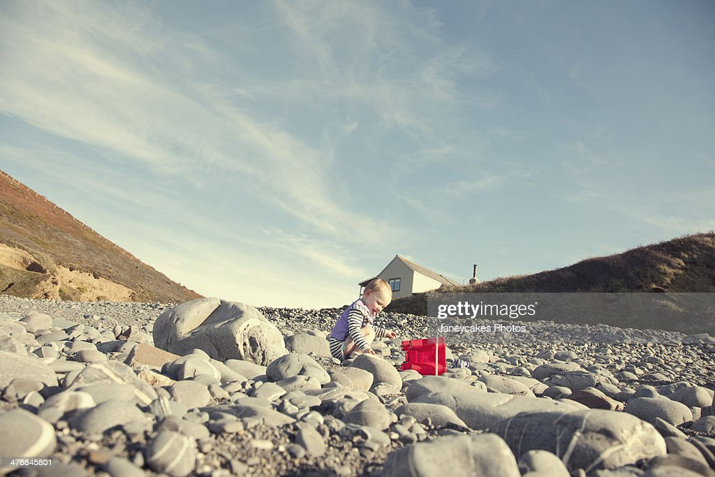 Baby girl playing on beach : Stock Photo