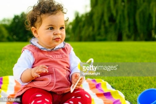 8 Month Old Baby Toys : Baby girl playing with toys outdoors stock photo getty