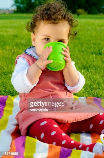 Toys For 9 Month Girl : Baby girl playing with toys outdoors stock photo getty